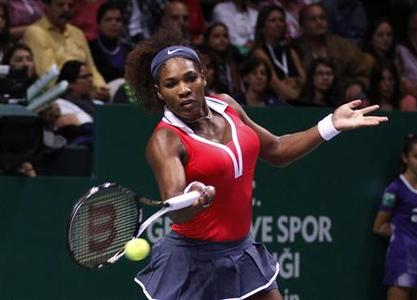 Serena Williams of the U.S. hits a return to Russia's Maria Sharapova during their final WTA tennis championships match in Istanbul, October 28, 2012. REUTERS/Osman Orsal