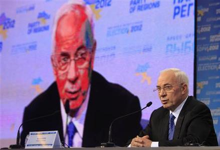 Ukraine's Prime Minister Mykola Azarov addresses the audience at the pro-President Yanukovich Regions Party's election headquarters in Kiev, October 28, 2012. REUTERS/Anatolii Stepanov