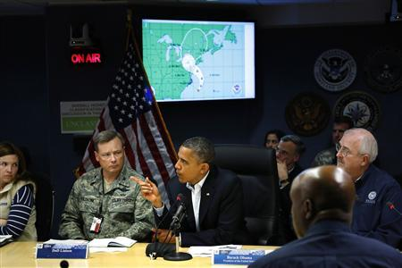 U.S. President Barack Obama (C) asks a question during a Federal Emergency Management Agency (FEMA) briefing about Hurricane Sandy, as it threatens the East Coast, at FEMA headquarters in Washington, October 28, 2012. REUTERS/Jonathan Ernst