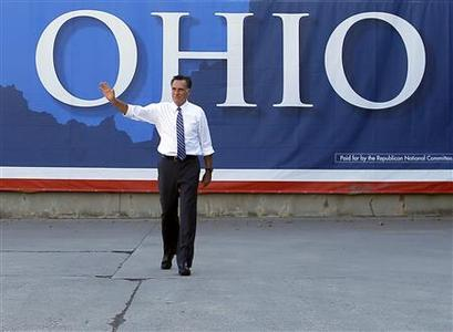 Republican presidential nominee Mitt Romney waves to the crowd at the conclusion of a campaign rally at Worthington Industries in Worthington, Ohio October 25, 2012. REUTERS/Brian Snyder
