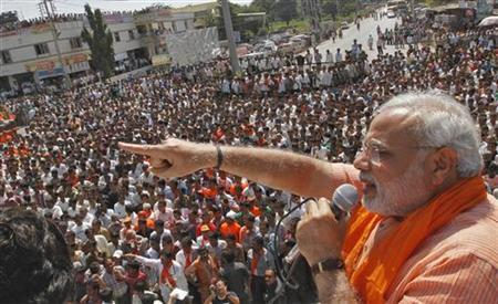 Gujarat's Chief Minister Narendra Modi addresses his supporters during an election campaign rally ahead of the state assembly elections at Dokar village in Gujarat October 11, 2012. REUTERS/Amit Dave