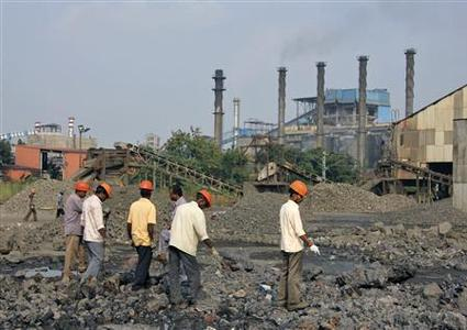 Employees work at a plant of Indian Metal and Ferro Alloys Limited (IMFA) at Choudwar in Cuttack district in the eastern Indian state of Odisha October 22, 2012. REUTERS/Stringer