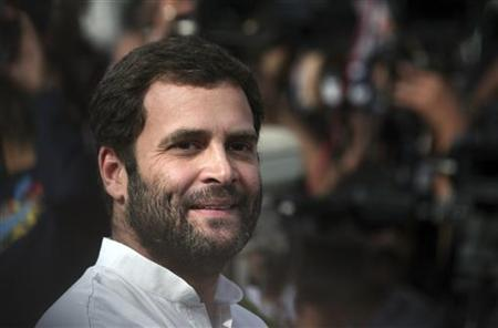 Rahul Gandhi, a lawmaker and son of ruling Congress party chief Sonia Gandhi, smiles as he speaks with the media in New Delhi March 6, 2012. REUTERS/Parivartan Sharma/Files
