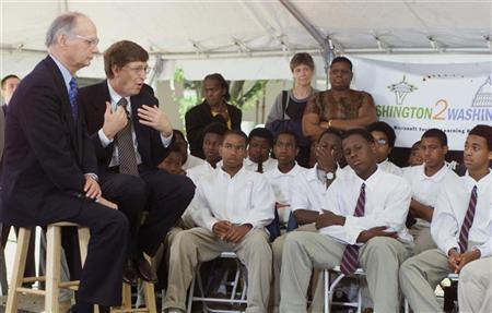 Bill Gates, chairman and chief software architect of Microsoft, and U.S. Secretary of Education Richard Riley (L) talk to a group of students at the SEED public charter school in Washington, June 6. Gates was talking to the students about technology and a new program called Washington2Washington. The Washington2Washington program will link two classrooms on opposite coasts for a year of interactive, technology-enabled learning.