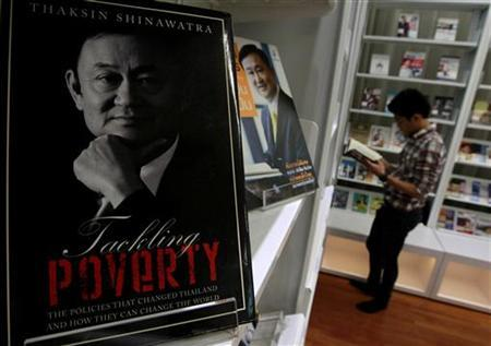 A book about Thailand's former Prime Minister Thaksin Shinawatra is displayed at the Puea Thai Party headquarters in Bangkok October 29, 2012. A cabinet reshuffle in Thailand has brought loyal allies of self-exiled Thaksin into the government led by his sister, consolidating his grip on power as he bides his time before making a serious effort to come home. REUTERS/Sukree Sukplang