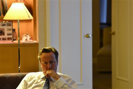 Prime Minister David Cameron listens during a private meeting with pressure group 'Hacked Off' at the Conservative Party conference in Birmingham, central England, October 9, 2012. REUTERS/Toby Melville