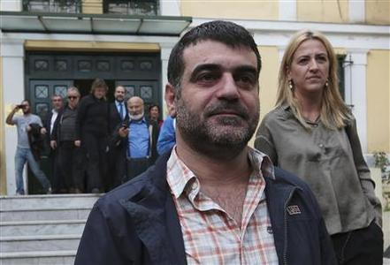 Greek editor Costas Vaxevanis (C) leaves a prosecutor's office in Athens October 28, 2012. REUTERS/Icon/Costas Baltas