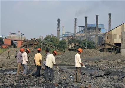 Employees work at a plant of Indian Metal and Ferro Alloys Limited (IMFA) at Choudwar in Cuttack district in Odisha October 22, 2012. REUTERS/Stringer