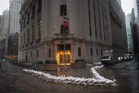 Sandbags block the entrance of the New York Stock Exchange in downtown Manhattan as Hurricane Sandy made its approach in New York October 29, 2012. Hurricane Sandy, the monster storm bearing down on the U.S. East Coast, strengthened on Monday after hundreds of thousands moved to higher ground, public transport shut down and the U.S. stock market suffered its first weather-related closure in 27 years. REUTERS/Andrew Kelly