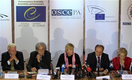 Members of the Parliamentary Assembly of the Organisation for Security and Cooperation in Europe (OSCE), led by vice-president of the Organization Walburga Habsburg Douglas (C), attend a news conference in Kiev, October 29, 2012. REUTERS/Anatolii Stepanov