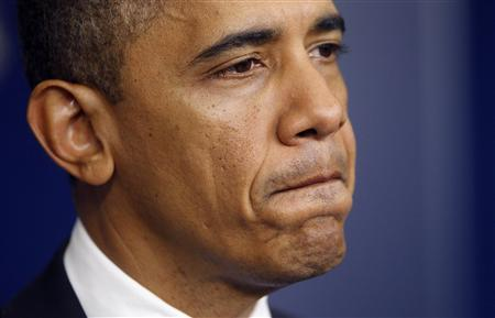 U.S. President Barack Obama pauses as he delivers a statement on the Hurricane Sandy situation from the press briefing room of the White House in Washington, October 29, 2012. REUTERS/Jason Reed