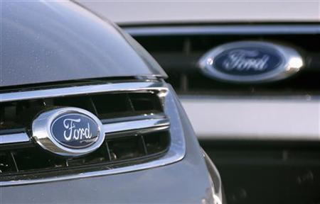 The logo of Ford Motor Company is seen on vehicles in a parking lot at the Ford assembly plant in Genk October 23, 2012. REUTERS/Francois Lenoir