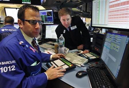Barclay's traders Michael Pistillo (L) and James Maher work on the floor of the New York Stock Exchange, October 24, 2012. REUTERS/Brendan McDermid