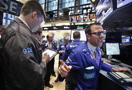 Barclay's trader Michael Pistillo (R) works at his post on the floor of the New York Stock Exchange October 25, 2012. REUTERS/Brendan McDermid
