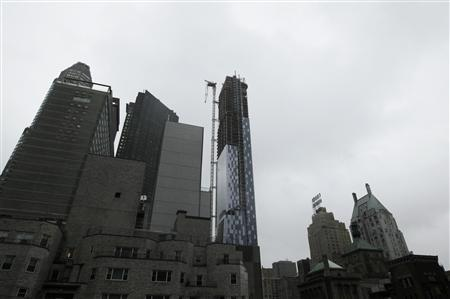 A partially collapsed crane hangs from a high-rise building in Manhattan as Hurricane Sandy makes its approach in New York October 29, 2012. REUTERS/Brendan McDermid