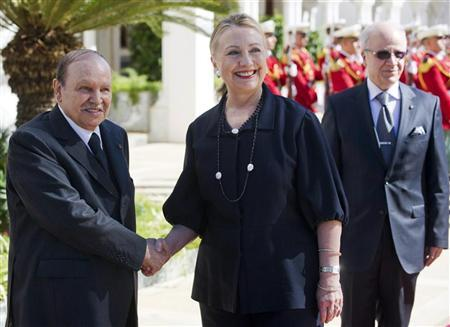 Algerian President Abdelaziz Bouteflika (L) shakes hands with U.S. Secretary of State Hillary Clinton as she arrives for meetings at the Mouradia Palace in Algiers October 29, 2012. REUTERS/Saul Loeb/Pool