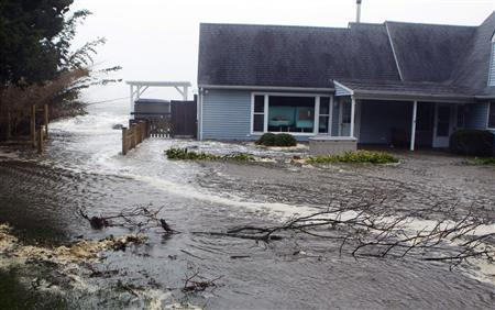 Storm surf kicked up by the high winds from Hurricane Sandy floods through a home in Southampton, New York October 29, 2012. REUTERS/Lucas Jackson