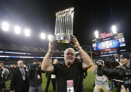 San Francisco Giants general manager Brian Sabean carries the World Series Trophy on the field after his team defeated the Detroit Tigers in Game 4 to win the MLB World Series baseball championship in Detroit, Michigan, October 28, 2012. REUTERS/Mark Blinch