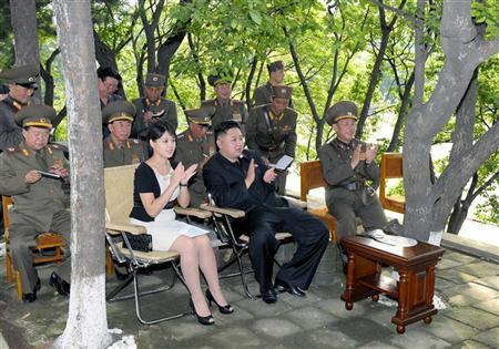 North Korean leader Kim Jong-Un (C) and his wife Ri Sol-Ju (front L) visit a sub-unit under the Korean People's Army Unit 552 in this undated picture released by the North's official KCNA news agency in Pyongyang August 7, 2012. REUTERS/KCNA