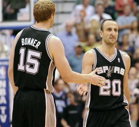 San Antonio Spurs power forward Matt Bonner (15) congratulates shooting guard Manu Ginobili (20) during the second half of their NBA basketball game in Salt Lake City, Utah, May 7, 2012. REUTERS/Eli Lucero