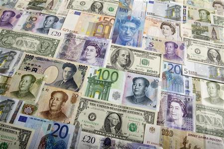 Arrangement of various world currencies including Chinese Yuan, Japanese Yen, US Dollar, Euro, British Pound, Swiss Franc and Russian Ruble pictured in Warsaw January 26, 2011. REUTERS/Kacper Pempel