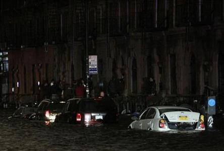 Flood waters brought on by Hurricane Sandy over run cars in New York's lower east side, October 29, 2012. REUTERS/Brendan McDermid