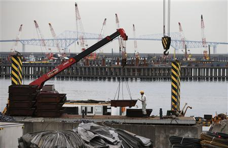 A man works in front of cranes at an industrial area in Tokyo October 30, 2012. REUTERS/Toru Hanai