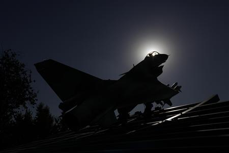 A replica of a Chinese Jian-10 fighter jet is seen outside the Aviation Industry Corporation of China (AVIC) headquarters building in Beijing October 30, 2012. REUTERS/Jason Lee