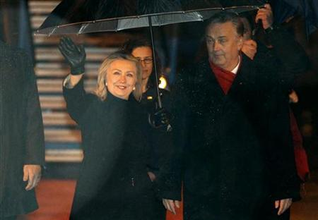 Bosnian Foreign Minister Zlatko Lagumdija walks with U.S. Secretary of State Hillary Clinton after she arrived on official visit at the airport in Sarajevo, October 29, 2012. REUTERS/Dado Ruvic