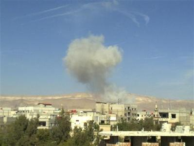 Smoke rises from what activists say was a missile fired by a Syrian Air Force fighter jet loyal to Syria's President Bashar al-Assad at Erbeen, near Damascus October 29, 2012. Picture taken October 29. REUTERS/Islam Al-Shami/Shaam News Network/Handout