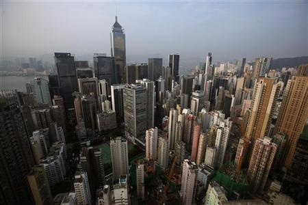 Highrise residential and commercial buildings are seen at Hong Kong island August 29, 2012. REUTERS/Bobby Yip