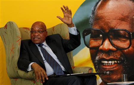 South African president Jacob Zuma gestures next to a portrait of late African National Congress (ANC) president Oliver Reginald Tambo, during a briefing with the South African Foreign Correspondents Association in Johannesburg October 29, 2012. REUTERS/Siphiwe Sibeko