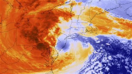 Post-Tropical Cyclone Sandy is seen as it makes landfall about five miles (8 km) southwest of Atlantic City, New Jersey in this National Oceanic and Atmospheric Administration (NOAA) Global Online Enrollment System (GOES)-13 satellite colorized infrared handout image taken at 8pm EST (0000 GMT) October 29, 2012. Sandy, one of the biggest storms ever to hit the U.S., roared ashore with fierce winds and heavy rain on Monday near the gambling resort of Atlantic City, forcing evacuations, shutting down transportation and interrupting the presidential campaign. Official projections from the National Hurricane Center have the storm moving westward through Pennsylvania and then moving north into New York. REUTERS/NOAA/Handout