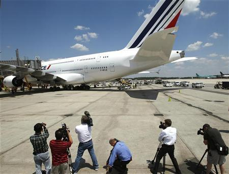 Members of the media photograph an Air France Airbus 380 after its maiden arrival at Dulles International Airport in Virginia June 6, 2011. REUTERS/Gary Cameron