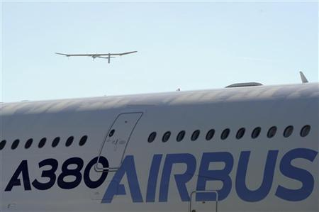 The solar-powered HB-SIA prototype aircraft takes part in a flying display as the Airbus A380 is seen in the foreground during the 49th Paris Air Show at the Le Bourget airport near Paris June 26, 2011. REUTERS/Gonzalo Fuentes