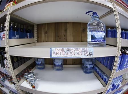 Few bottles of water remain on the shelf at Trader Joe's supermarket in New York October 28, 2012. REUTERS/Carlo Allegri