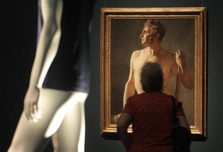 A visitor looks at the painting ''Male Torso'' by French painter Jean Auguste Dominique Ingres during a preview of the art exhibition 'Nude Men' at the Leopold museum in Vienna October 18, 2012. REUTERS/Heinz-Peter Bader