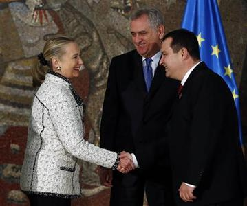 U.S. Secretary of State Hillary Clinton is welcomed by Serbian President Tomislav Nikolic (C) and Serbian Prime Minister Ivica Dacic (R) prior to their meeting in Belgrade October 30, 2012. REUTERS/Marko Djurica