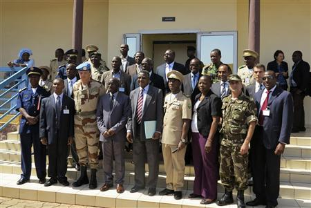 Mali's Defence Minister Yamoussa Camara (front row, 4th L) poses with a group of military experts and officials taking part in a meeting to discuss the Mali crisis in Bamako October 30, 2012. REUTERS/Adama Diarra