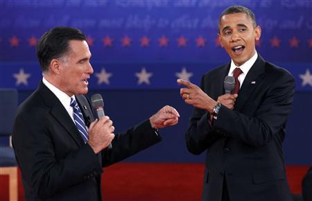 U.S. Republican presidential nominee Mitt Romney (L) and U.S. President Barack Obama answer a question at the same time during the second U.S. presidential campaign debate in Hempstead, New York, October 16, 2012. REUTERS/Jim Young
