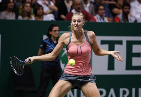 Russia's Maria Sharapova hits a return to Serena Williams of the U.S. during their final WTA tennis championships match in Istanbul, October 28, 2012. REUTERS/Osman Orsal