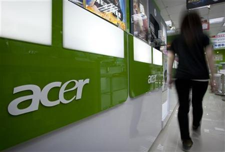 A woman walks into an Acer store located in the Guanghua Market area in Taipei October 23, 2012. REUTERS/Yi-ting Chung