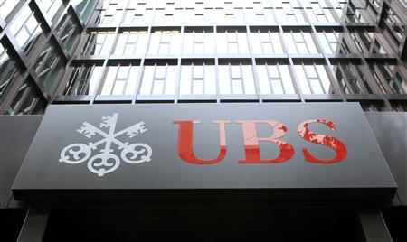The company's logo is seen at an office building of Swiss bank UBS in Basel, in this file picture taken October 28, 2012. REUTERS/Arnd Wiegmann/Files