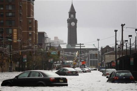 Car are seen on a street flooded at Hoboken in New Jersey, October 30, 2012. REUTERS/Eduardo Munoz
