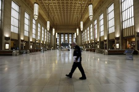 An Amtrak police officer patrols the empty 30th Street Station after all rail travel was cancelled due to damage caused by Hurricane Sandy in Philadelphia, Pennsylvania, October 30, 2012. REUTERS/Laurence Kesterson