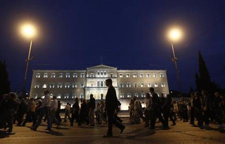 Banking sector employees march in front of the parliament during a rally against planned reforms at their pension fund in central Athens October 30, 2012. REUTERS/John Kolesidis