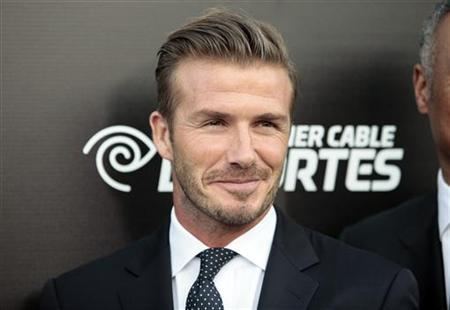 Major League Soccer (MLS) player David Beckham arrives at the Time Warner Cable Sports launch event for Time Warner Cable SportsNet and Time Warner Cable Deportes in El Segundo, California October 1, 2012. REUTERS/Jason Redmond