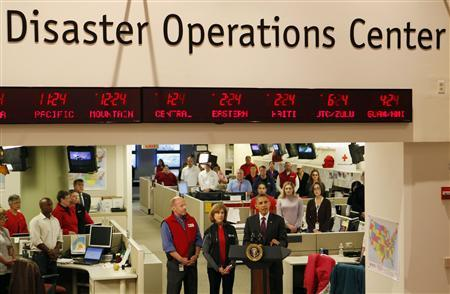 U.S. President Barack Obama talks about the damage done by Hurricane Sandy and rescue efforts while in the Disaster Operations Center at the National Red Cross Headquarters in Washington, October 30, 2012. REUTERS/Larry Downing