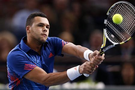 Jo-Wilfried Tsonga of France returns the ball to Julien Benneteau of France during the Paris Masters tennis tournament October 30, 2012. REUTERS/Benoit Tessier