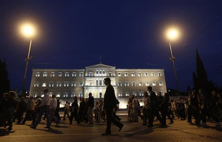 Banking sector employees march in front of the parliament during a rally against planned reforms at their pension fund in central Athens October 30, 2012. A Greek coalition partner confirmed on Tuesday it would vote against labour reforms proposed by foreign lenders, ignoring the prime minister's appeal for a united front to push through more unpopular austerity. REUTERS/John Kolesidis